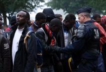 Evacuation d'un campement de réfugiés à Paris