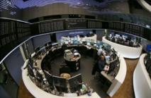 Recul des actions en Europe, records à Wall Street, bond du sterling