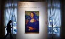 """La """"Rubik Mona Lisa"""" d'Invader adjugée à plus de 480.000 euros à Paris"""