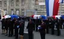 Attentats: hommages et obsèques, avant la réplique du gouvernement
