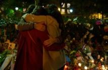 Attentats de Paris: place au deuil, au moins un suspect en fuite